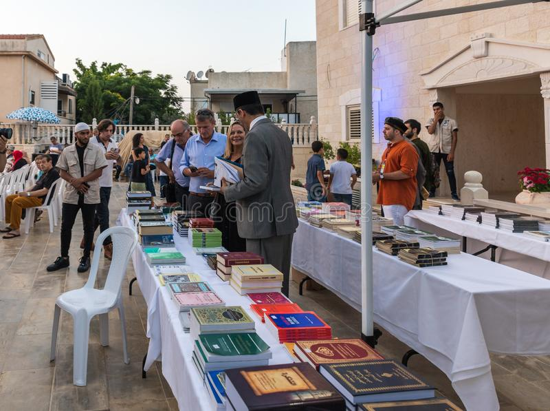 Evening sale of holy books about Islam in the courtyard of the Ahmadiyya Shaykh Mahmud mosque in Haifa city in Israel. Haifa, Israel, July 11, 2019 : Evening stock images