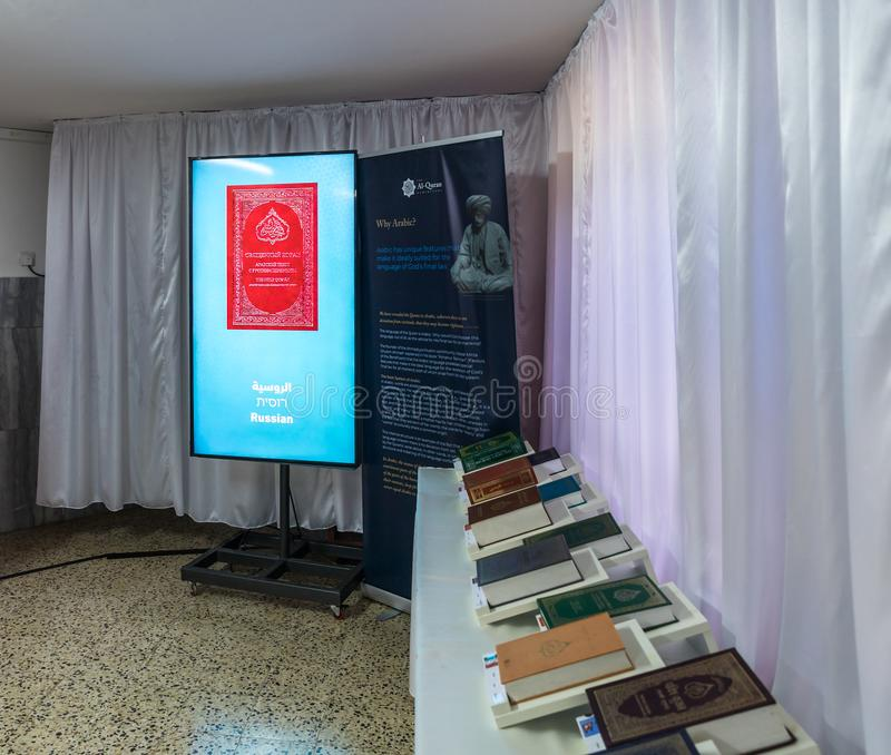 Holy books and manuals in different languages in the hall of the prayer hall in the Ahmadiyya Shaykh Mahmud mosque in Haifa city i. Haifa, Israel, July 11, 2019 royalty free stock photo