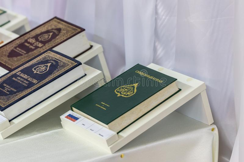 The Holy Quran book in Russian is on the table next to books in other languages in the Ahmadiyya Shaykh Mahmud mosque in Haifa cit. Haifa, Israel, July 11, 2019 stock photo