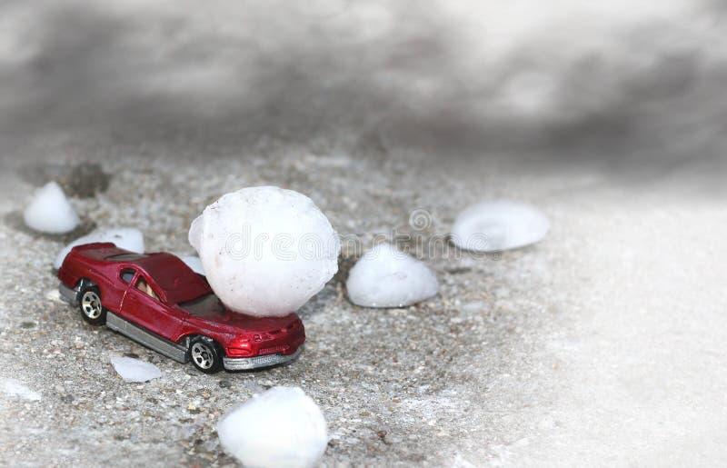 Hail Damage. A rd car damaged by large hail stock image