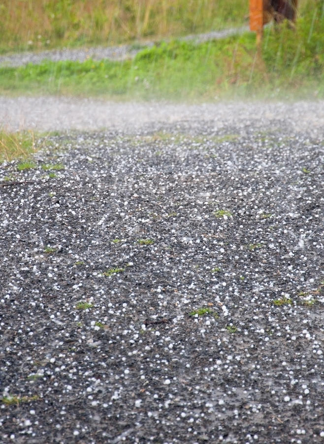 Hail downfall. Hail on the ground during a thunderstorm near Ostersund in Northern Sweden on a summer day stock photo
