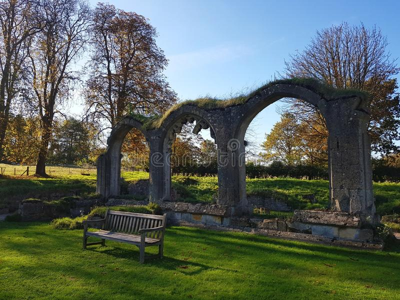 Hailes Abbey ruins in Cotswold, United Kingdom. Hailey abbey ruins in cotswold, monastry, bench, history, travel, destination, place, interest, trees stock image