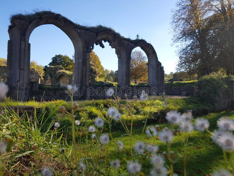 Hailes Abbey ruins in Cotswold, United Kingdom. Hailey abbey ruins in cotswold, monastry, bench, history, travel, destination, place, interest, trees royalty free stock photography