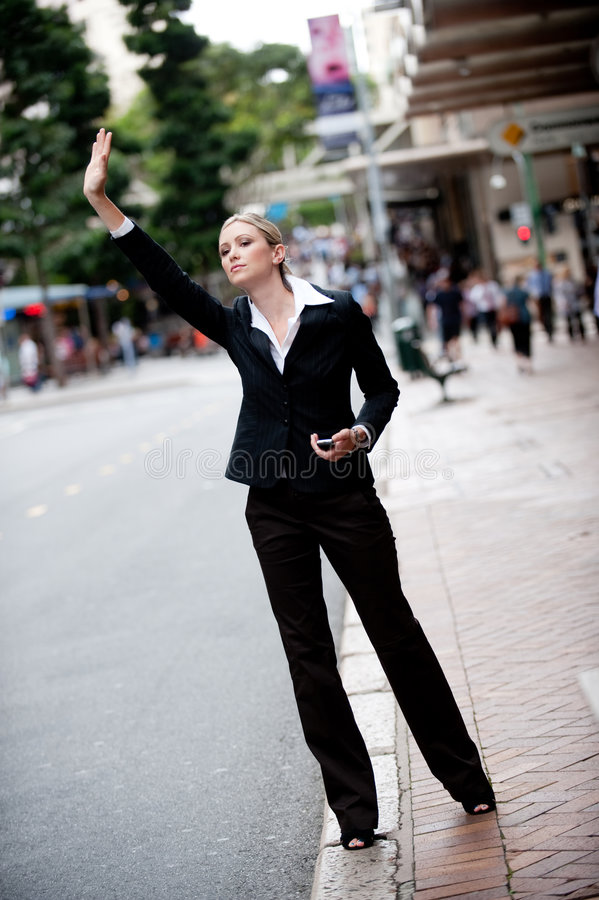 Hailing A Cab Royalty Free Stock Photography