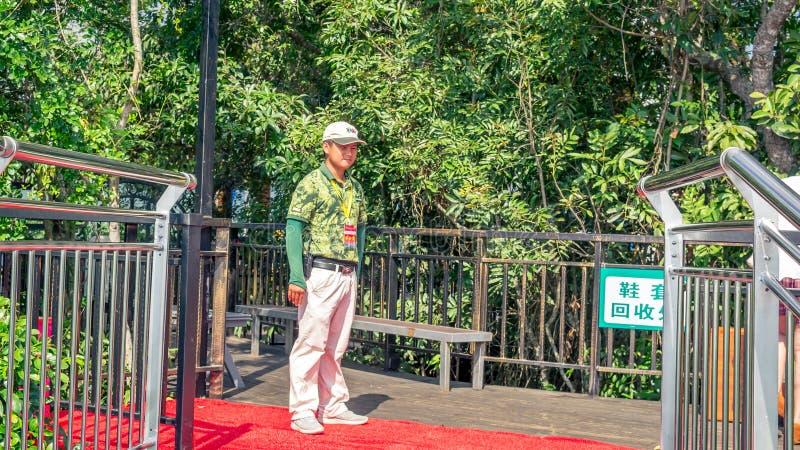 Hainan, China - May 17, 2019: Service staff, ranger. Rainforest Cultural Tourism Zone Hainan island, Forest Park Yanoda. Hainan island, China - May 17, 2019 royalty free stock photo