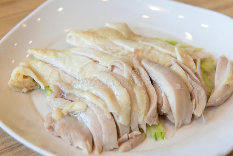 hainanese boiled chicken on white dish in restaurant royalty free stock image