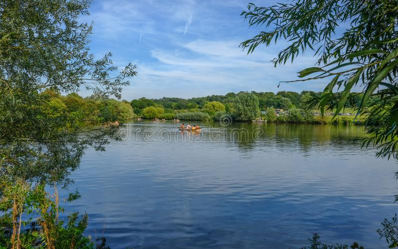 Hainault Forest, Essex, UK - August 28, 2017: Girls in a rowing royalty free stock photo