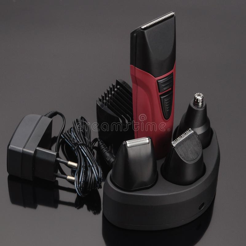 Hair Barber Clippers, Haircut accessories on grey mirror background royalty free stock photography