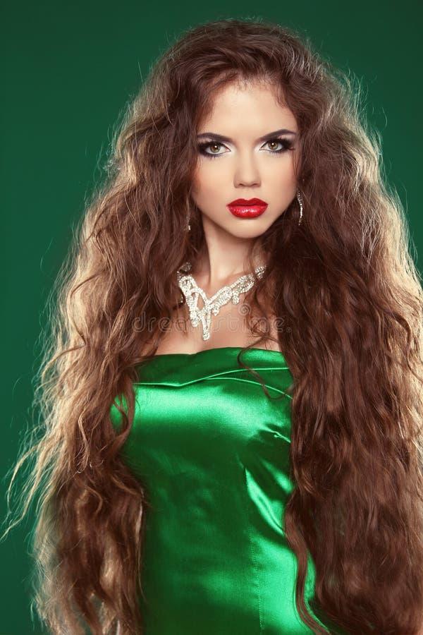 Hair. Beautiful Brunette Woman. Healthy Long Brown Hair. Be stock photos