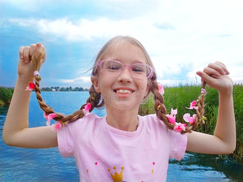 Hair bloomed. The young girl`s hair blossomed with pink flowers stock image