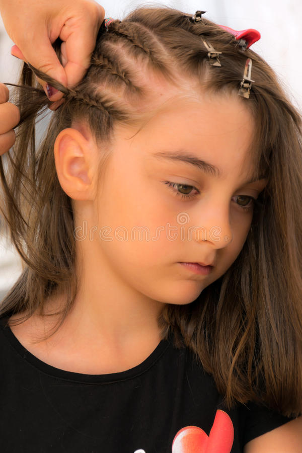 Hair braids. Hairdresser make braids in beauty salon stock image