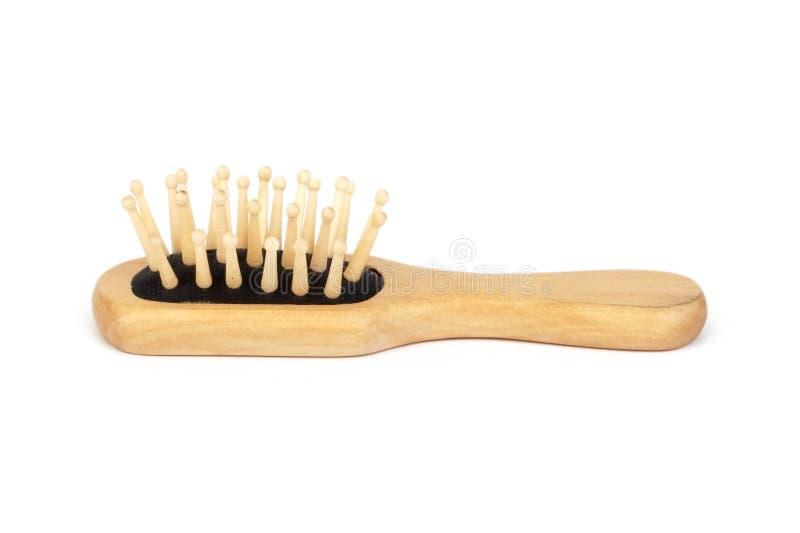 Hair brush. Wooden hair brush royalty free stock photo