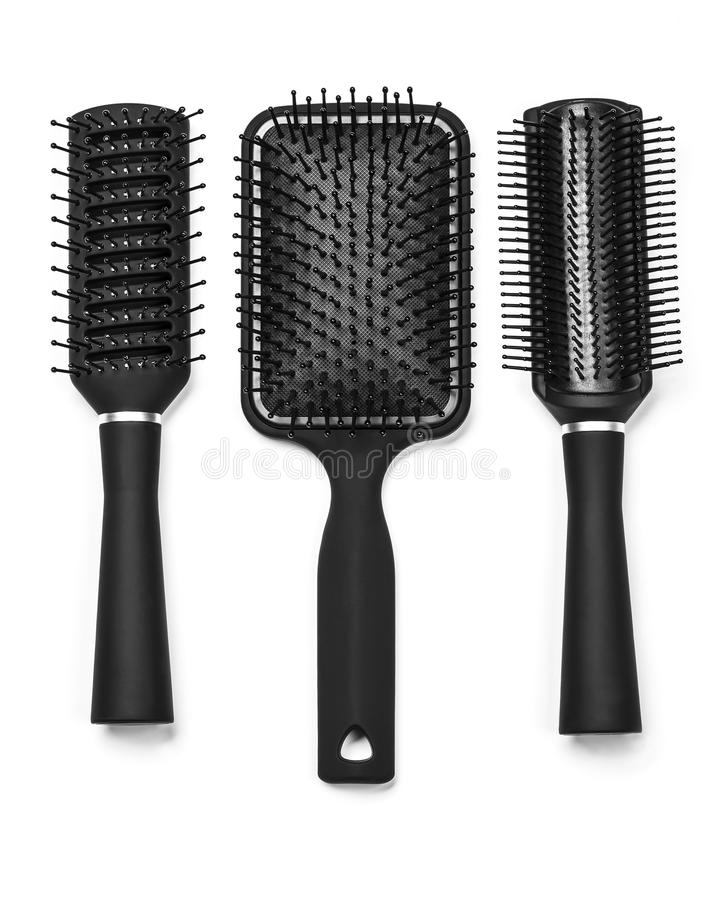 Hair brushes. A new hair brushes in detail isolated on white background royalty free stock photography