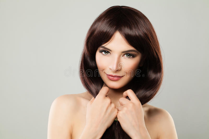 Hair Care Concept. Healthy Woman with Brown Hair. Hair Care Concept. Healthy Woman with Long Shiny Hairstyle. Beautiful Smiling Lady with Brown Hair for Beauty stock image