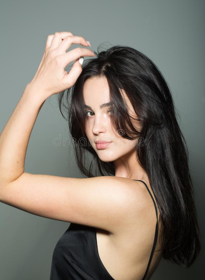 Hair care, style, styling. Sensual woman with brunette healthy hair, hairstyle. Sexy girl with makeup face, skincare. Beauty salon, hairdresser. Fashion look stock images