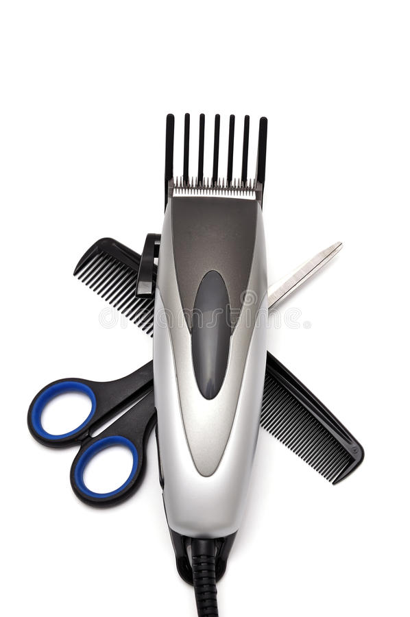 Hair clipper, comb and scissors stock photos