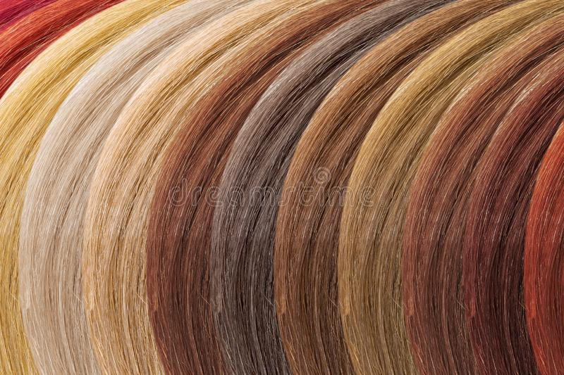 Hair colors palette as background. Dyed samples royalty free stock photography