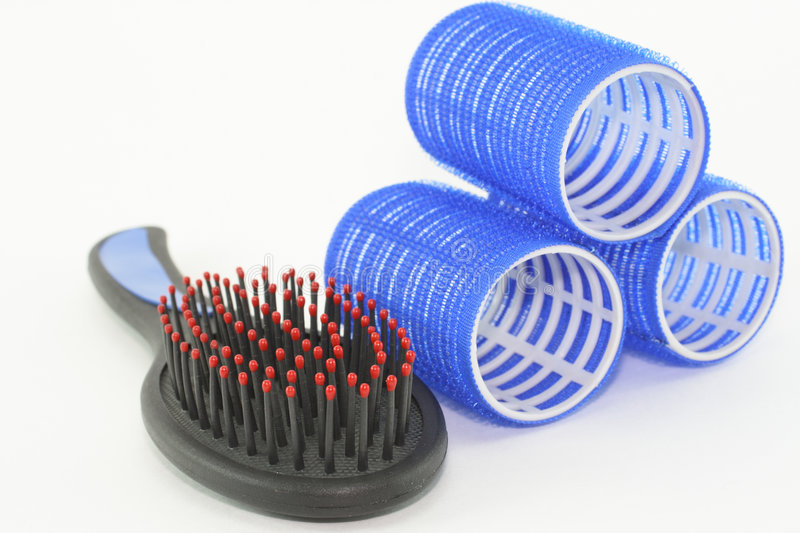 Hair curlers and hairbrush stock photography