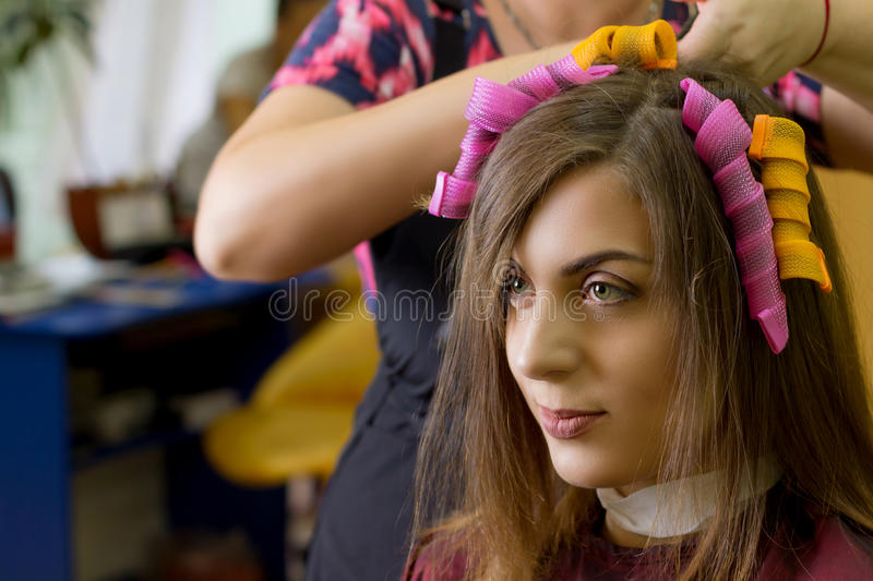 Hair curling process royalty free stock photo