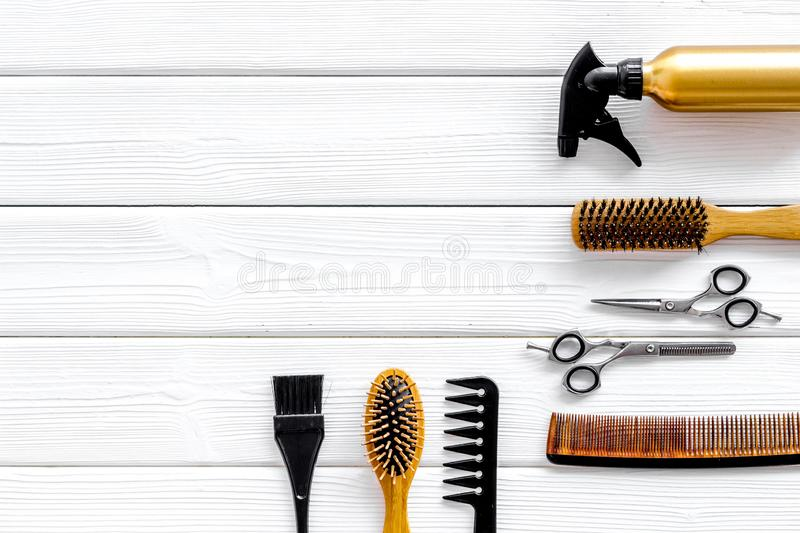Professional accessories of hairdresser with combs and sciccors on work desk wooden white background top view copyspace. Hair cut concept. Professional stock photography
