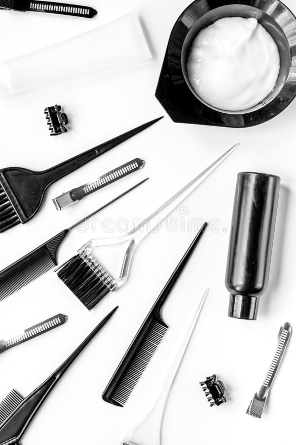 Hair dye with brush on white table background top view stock photography