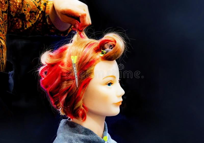 Hair dyeing, Hairstyles on dummy head of hair salon stock photography