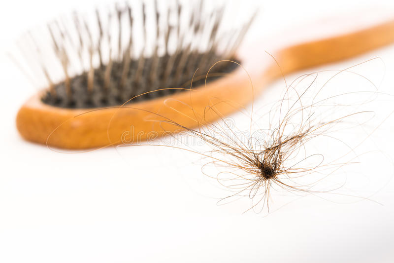 Hair fall and brush royalty free stock image