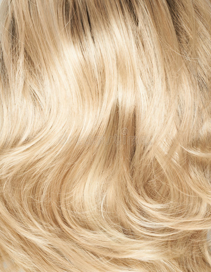 Hair fragment as a background composition. Open wave hair fragment as a texture background composition royalty free stock photo
