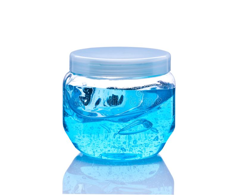 Hair gel. Bank with blue gel for hair on a white background royalty free stock images