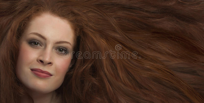 Hair gorgeous. Young woman with luxurious hair royalty free stock photos