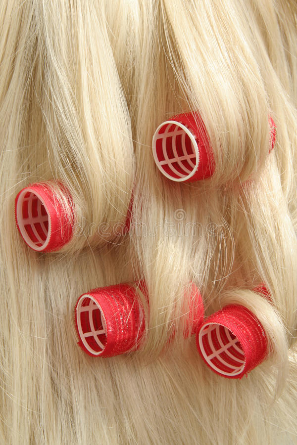 Hair in hair rollers stock image