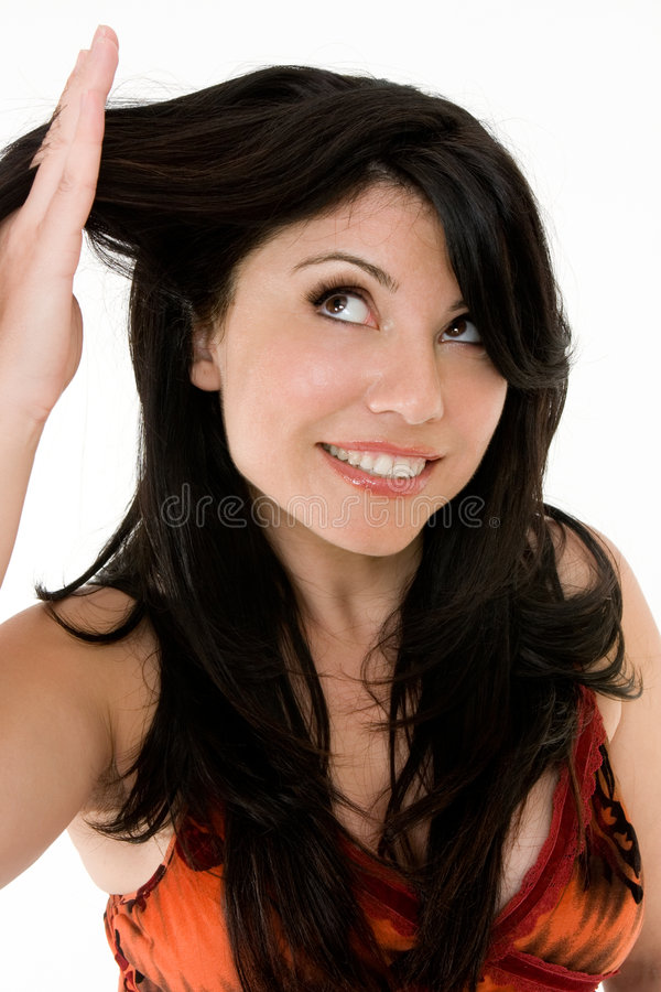 Hair Health. How healthy is your hair? A woman looking at the condition of her hair