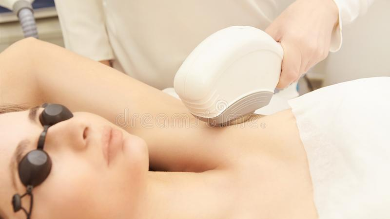 Hair laser removal service. IPL cosmetology device. Professional apparatus. Woman soft skin care stock photography