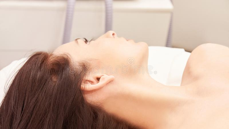 Hair laser removal service. IPL cosmetology device. Professional apparatus. Woman soft skin care.  stock images