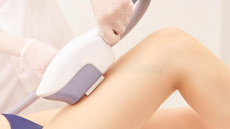 Hair laser removal service. IPL cosmetology device. Professional apparatus. Woman soft skin care. Leg royalty free stock photo