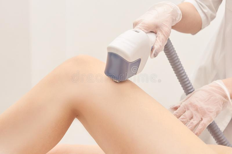 Hair laser removal service. IPL cosmetology device. Professional apparatus. Woman soft skin care. Leg stock images