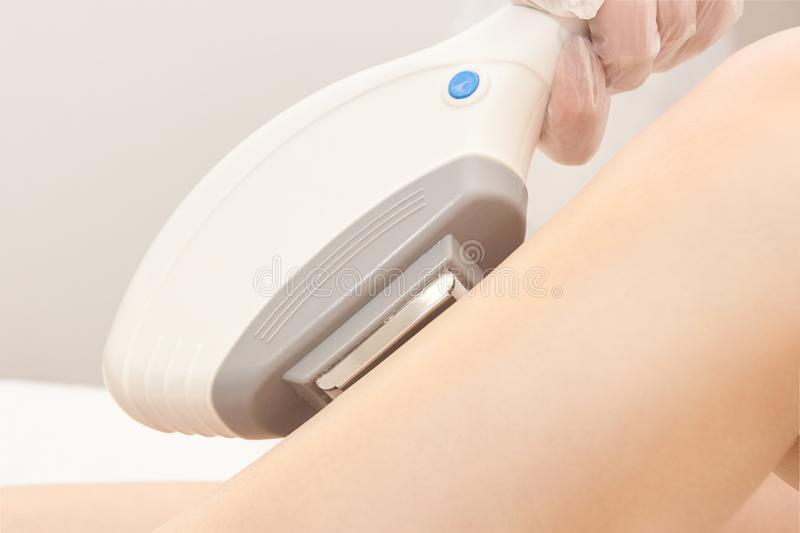 Hair laser removal service. IPL cosmetology device. Professional apparatus. Woman soft skin care royalty free stock image