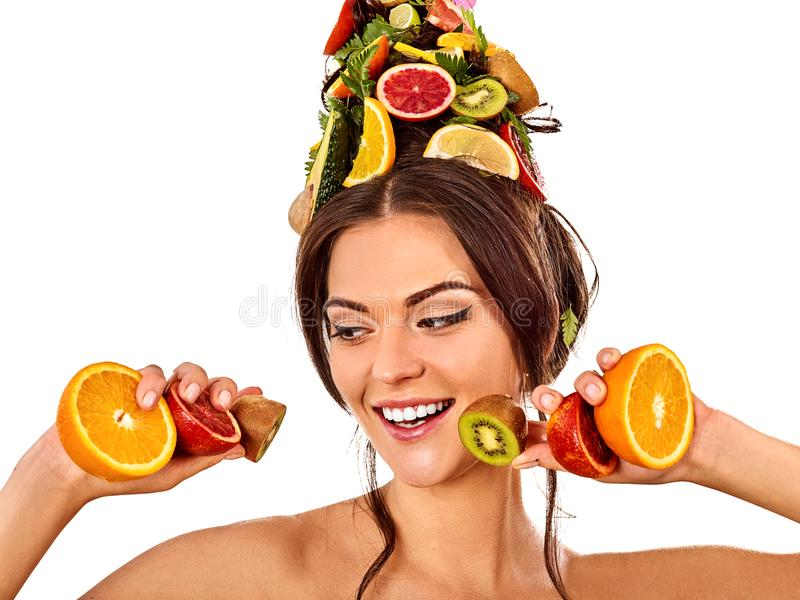 Hair mask from fresh fruits on woman head. Bare shoulders stock photo