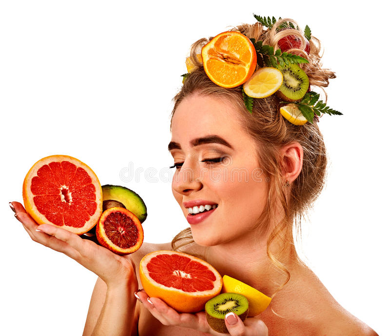 Hair mask from fresh fruits on woman head. Girl with beautiful face. Hair mask from fresh exotic fruits on woman head. Girl with beautiful face hold ingredient royalty free stock photo