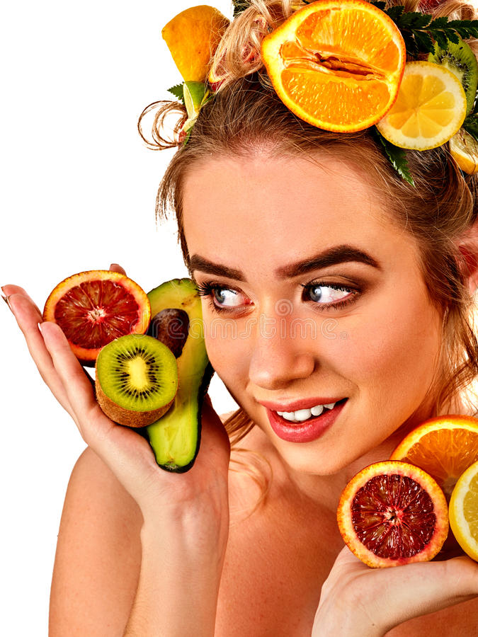 Hair mask from fresh fruits on woman head. Girl with beautiful face. Hair mask from fresh fruits on woman head. Girl with beautiful face hold ingredient for stock images