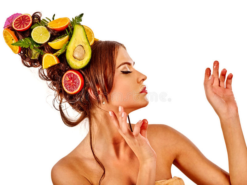 Hair mask from fresh fruits on woman head and spring flowers. Hair mask from fresh fruits on woman head. Portrait in profile of girl with beautiful face and stock images