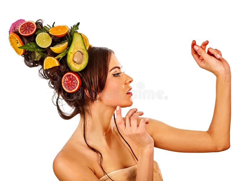 Hair mask from fresh fruits on woman head and spring flowers. Hair mask from fresh fruits on woman head. Portrait in profile of girl with beautiful face and stock image