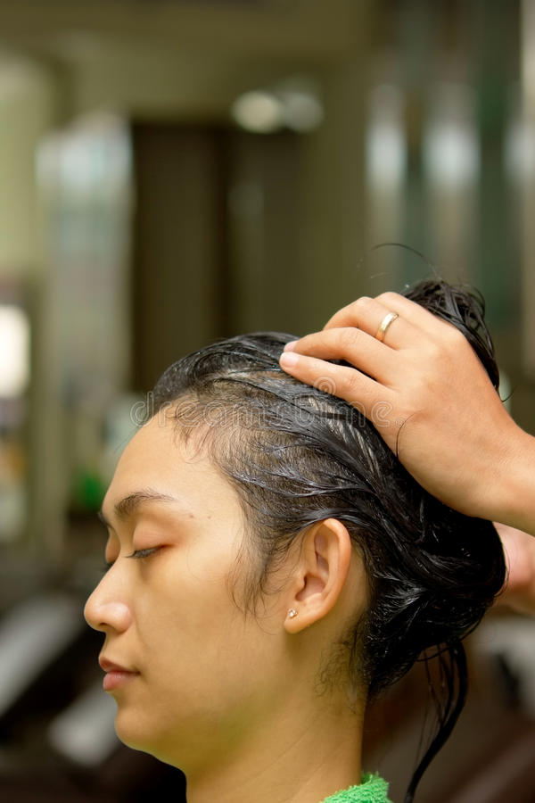 Hair massage at salon stock image