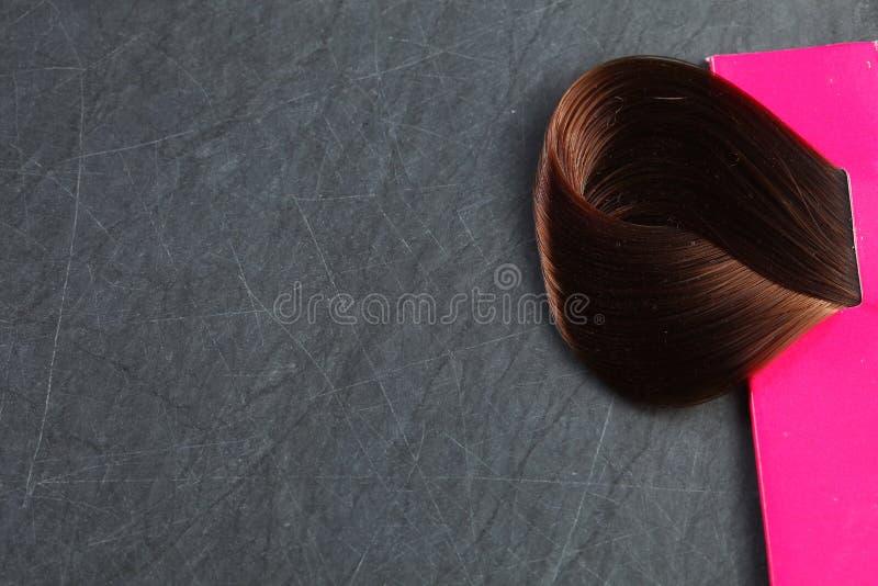 Hair piece on slate board scene. stock images
