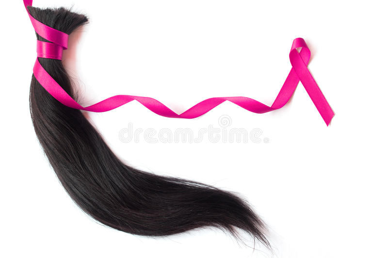 Hair with pink satin ribbon. Isolated on white background stock photography