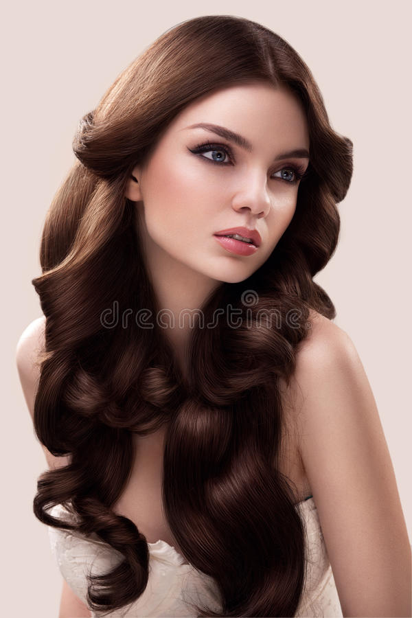 Hair. Portrait of Beautiful Woman with Long Wavy Hair. High quality image. royalty free stock photography