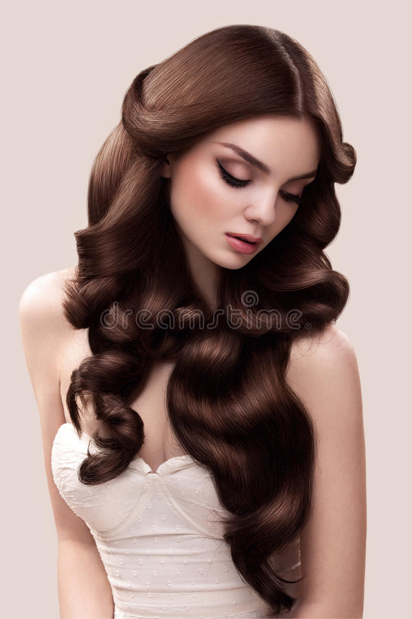 Hair. Portrait of Beautiful Woman with Long Wavy Hair. High quality image. stock images