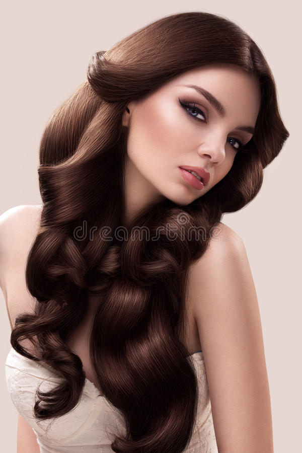 Hair. Portrait of Beautiful Woman with Long Wavy Hair. High quality image. royalty free stock images