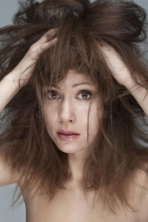 Hair problem. Young woman with refractory problem hair stock image