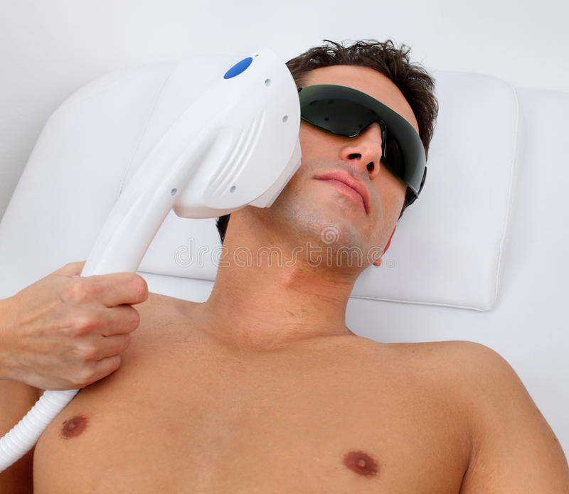 Hair removal. Laser hair removal in professional studio royalty free stock photography